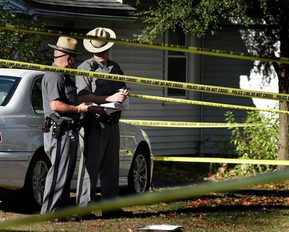 New York State Police troopers continue to secure the scene of a quadruple homicide at 1846 Western Avenue Friday morning, Oct. 10, 2014, in Guilderland, N.Y. (Skip Dickstein/Times Union) Photo: SKIP DICKSTEIN