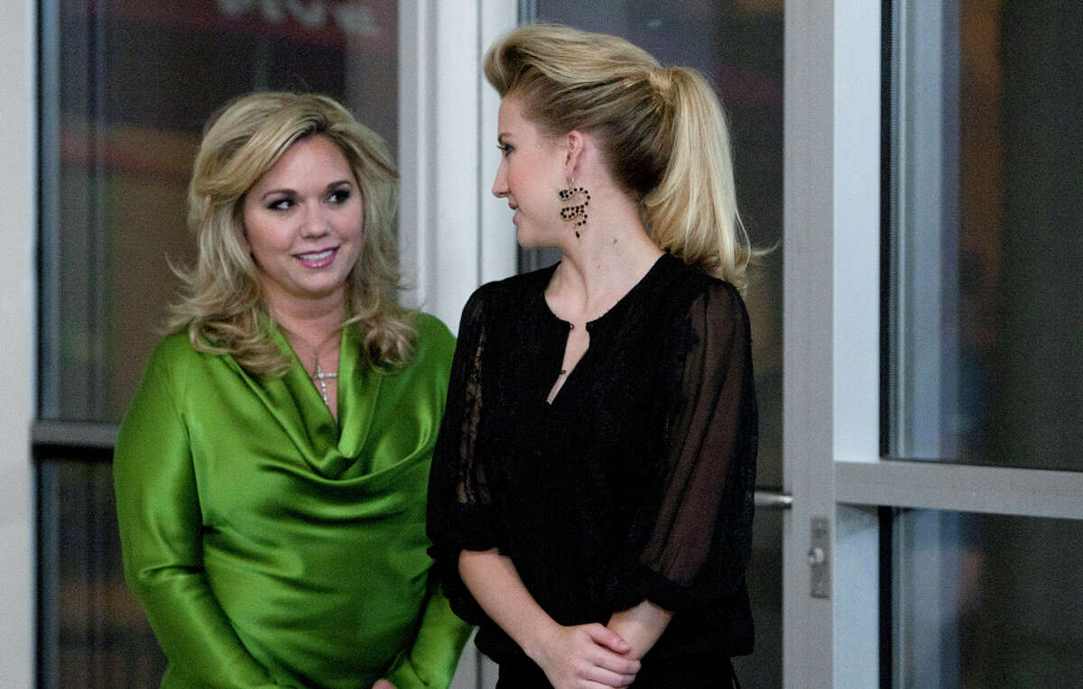 Todd Chrisley's wife, Julie (left), and 16-year-old daughter, Savannah, keep Chrisley on his toes in the reality-TV show.