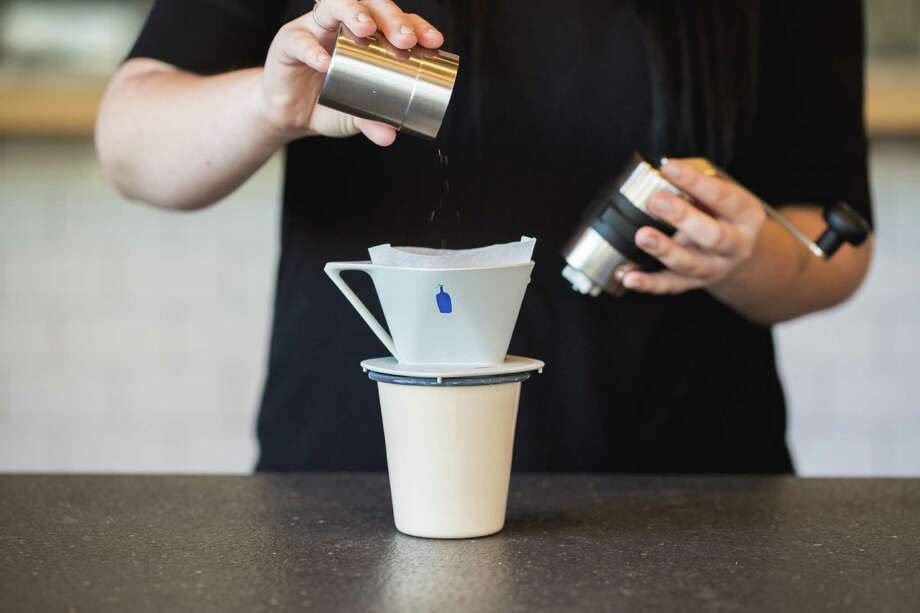 The Timbuk2 x Blue Bottle Travel Kit ($179) comes with a Porlex mini hand grinder, travel dripper, compostable filters, Falcon Enamelware tumblers, Blue Bottle's Three Africans drip blend coffee and custom felt koozies. Photo: Alicia Cho / Timbuk2 X Blue Bottle / ONLINE_YES