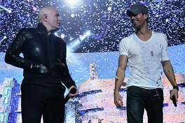 NEWARK, NJ - SEPTEMBER 12:  Enrique Iglesias and Pitbull with special guest J Balvin perform at opening night of U.S. tour at Prudential Center on September 12, 2014 in Newark, New Jersey.