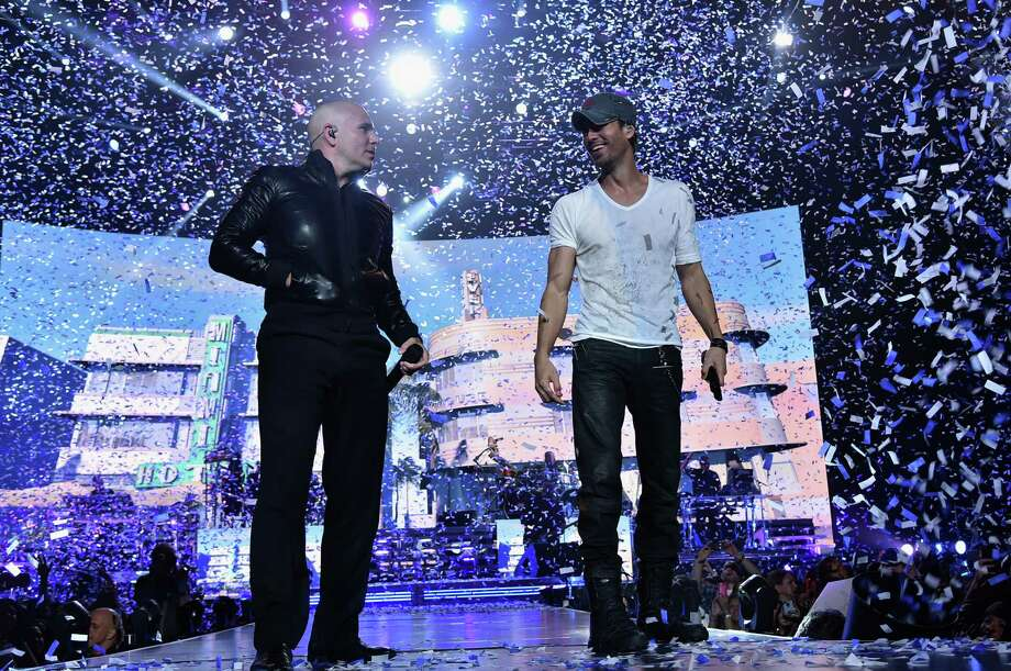 FILE — Enrique Iglesias and Pitbull perform at opening night of their U.S. tour September 12, 2014 in Newark, New Jersey. The pair will heat up the Laredo Energy Arena September 23, 2017, on a co-headlining tour. Click through to see which stars will be in the Gateway City next. Photo: Theo Wargo, Getty Images For AEG Live / 2014 Getty Images