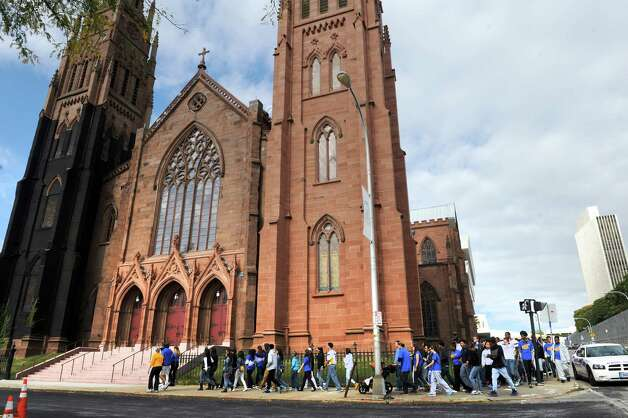 Students and educators from Bishop Maginn high school and two other diocese-owned Catholic schools participate in a walkathon for public service from Maginn through Lincoln Park to the Cathedral of the Immaculate Conception on Friday Oct. 10, 2014 in Albany, N.Y.  (Michael P. Farrell/Times Union) Photo: Michael P. Farrell / 10028985A