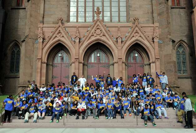 Students and educators from  Bishop Maginn high school and two other diocese-owned Catholic schools participate in a walkathon for public service from Maginn through Lincoln Park to the Cathedral of the Immaculate Conception on Friday, Oct. 10, 2014, in Albany, N.Y.  (Michael P. Farrell/Times Union) Photo: Michael P. Farrell / 10028985A