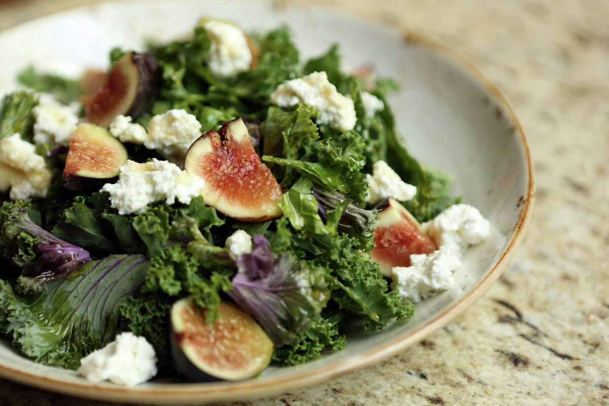 Kale & Fig Salad is served at Main Kitchen in JW Marriott Hotel in downtown Houston.