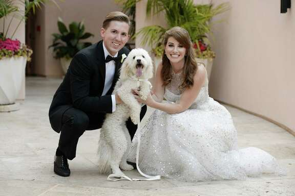 Samuel Ross Moore and Stephanie Lauren Kahan with their dog, Doodle, on their wedding day at the Hotel Bel Air in Beverly Hills, California on August 30, 2014.