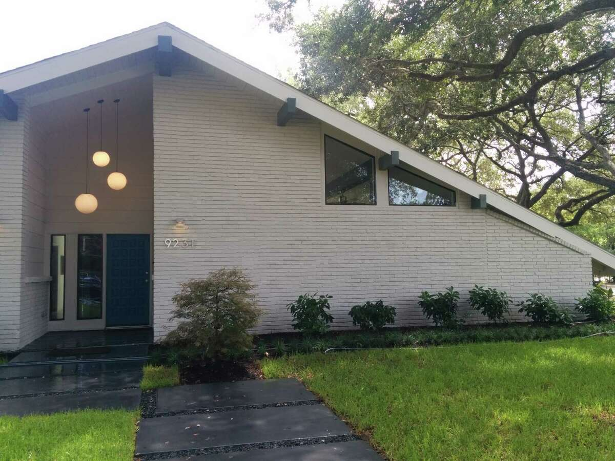 Dave Seeburger of P&G Homes and designer Jamie House brought a crumbling mid-century modern home in Woodshire back to life.