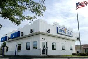 A White Castle restaurant in Columbus, Ohio is shown Monday June 21, 2004. Several teen clothing retailers, including Hot Topic, Buckle and Urban Outfitters, have started selling clothing that features White Castle's logo and slogans, including ``A legend in a Bun'', since a local T-shirt company licensed the brand last fall. (AP Photo/Jay LaPrete)