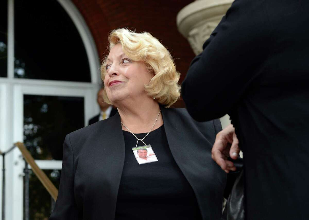 Marguerite Scalesse, mother of John Scalesse who was killed in a motorcycle accident in 2012, came to Superior Court in Bridgeport, Conn., Friday, Oct. 10, 2014, to see Aaron Huntsman sentenced for the theft of her son's belongings. The former state trooper earlier pleaded guilty to third-degree larceny and tampering with evidence for stealing cash and a necklace from the scene of the accident. He was sentenced to one year in prison.