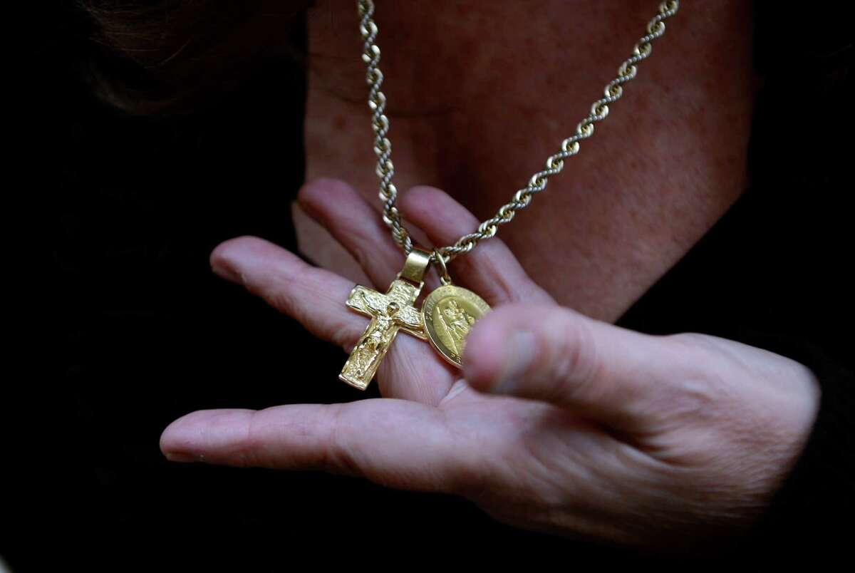 The gold chain and crucifix stolen by Aaron Huntsman, the former state trooper who earlier pleaded guilty to third-degree larceny and tampering with evidence for stealing cash and the necklace, belonging to John Scalesse, from the scene of an accident. Huntsman was sentenced before Judge Robert Devlin Friday, Oct. 10, 2014 at Superior Court in Bridgeport, Conn.
