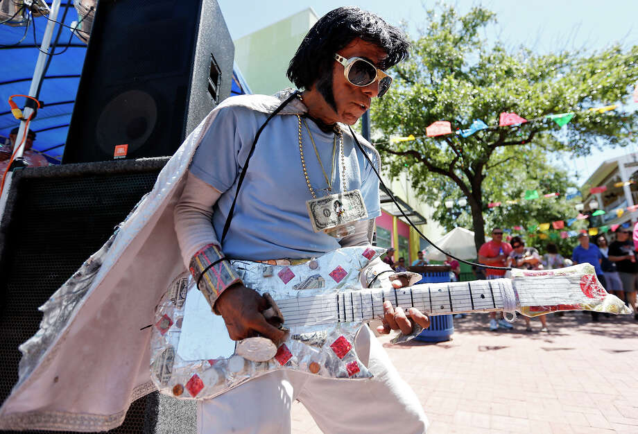 Hispanic Elvis performs during a Cinco de Mayo celebration in Market Square. He has become a favorite of visitors to downtown San Antonio. Photo: Edward A. Ornelas / San Antonio Express-News / © 2013 San Antonio Express-News