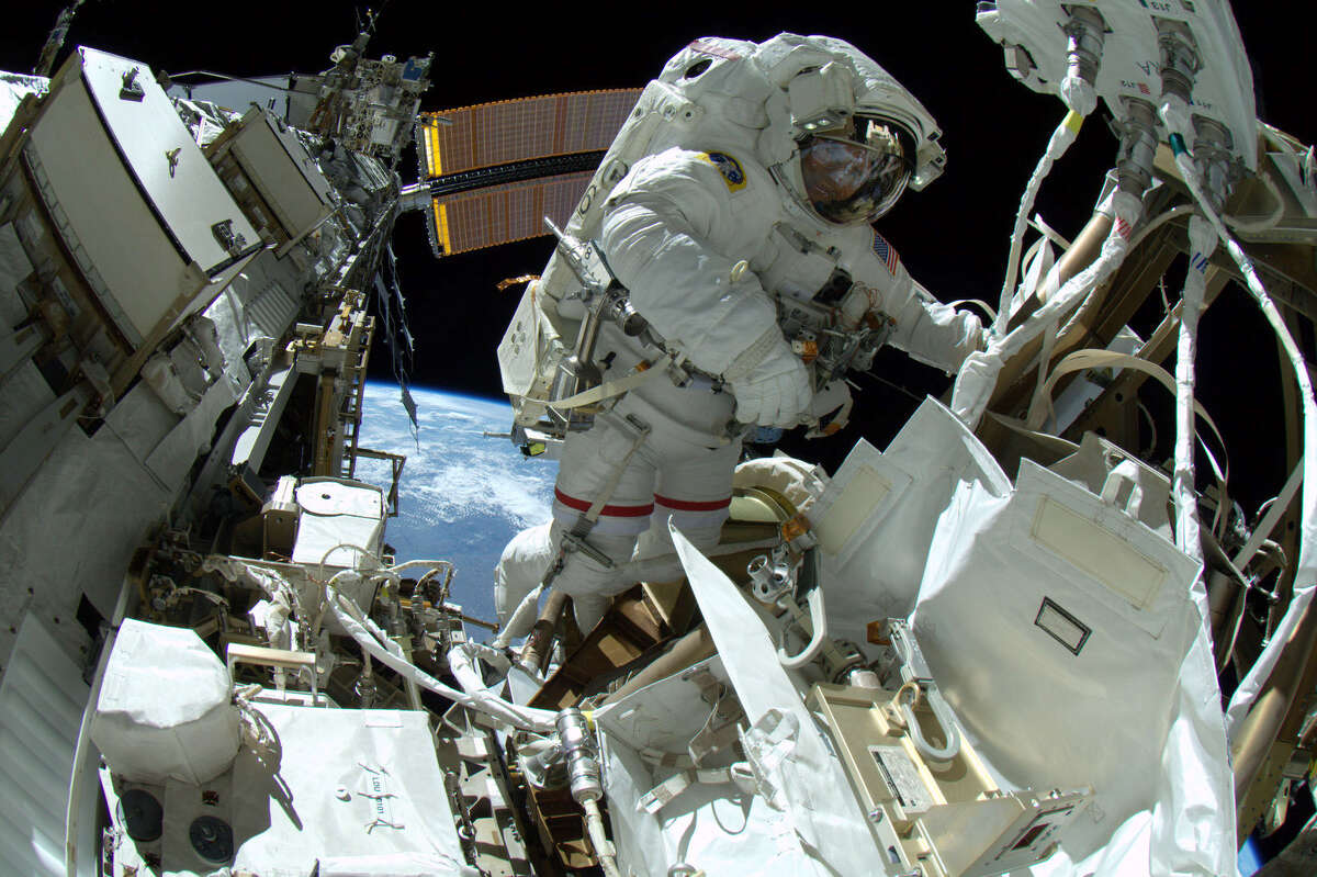Astronaut Reid Wiseman works outside the International Space Station during the first of three Expedition 41 spacewalks planned this October. (NASA)
