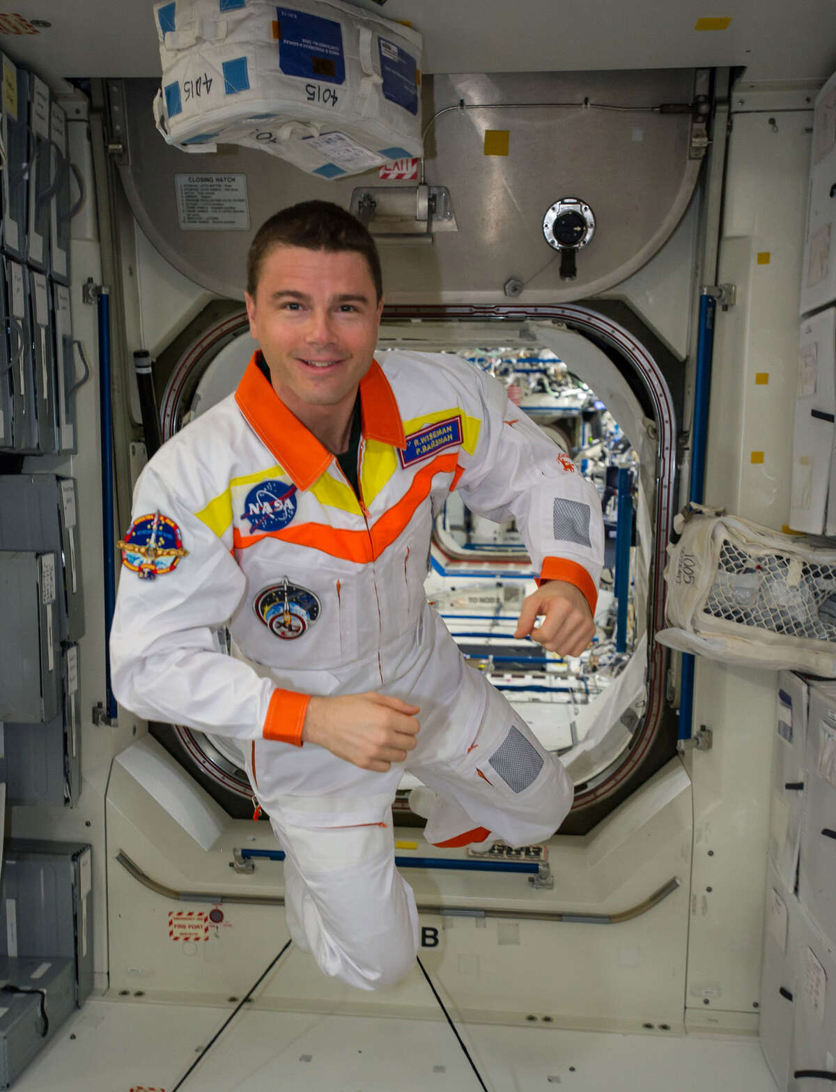 NASA astronaut Reid Wiseman is pictured while floating freely in the Unity node of the International Space Station. (NASA)