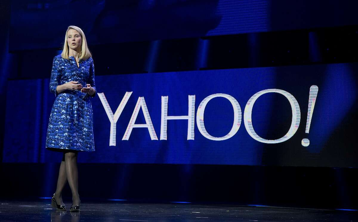 FILE - In this Jan. 7, 2014 file photo, Yahoo President and CEO Marissa Mayer speaks during the International Consumer Electronics Show in Las Vegas. In a letter on Friday, Sept. 26, 2014, activist investor Jeffrey Smith urged Yahoo Inc. to buy another fallen Internet star, AOL Inc. and take steps to reduce the future taxes on the company's lucrative stake in China's Alibaba Group. (AP Photo/Julie Jacobson, File)