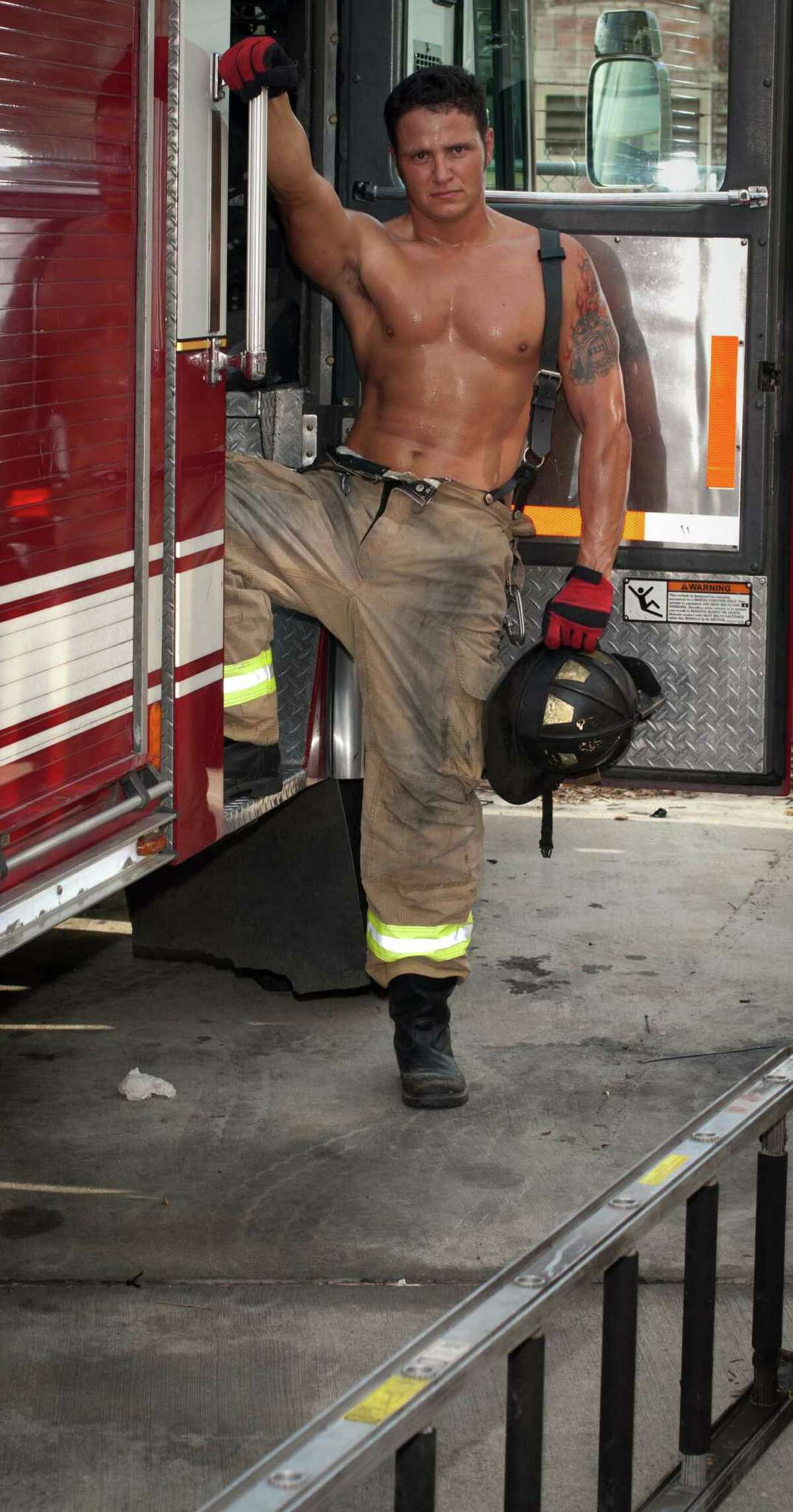 Ready for action A 2014 Houston firefighter calendar model is ready to ride.