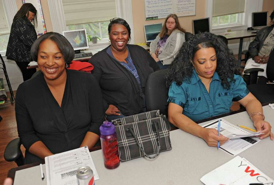 Recipient of the Woman of Inspiration award, Wilhelmina Hicks, center, interacts with women at the YWCA on Friday, Oct. 10, 2014, in Troy, N.Y. (Lori Van Buren / Times Union) Photo: Lori Van Buren / 10028948A