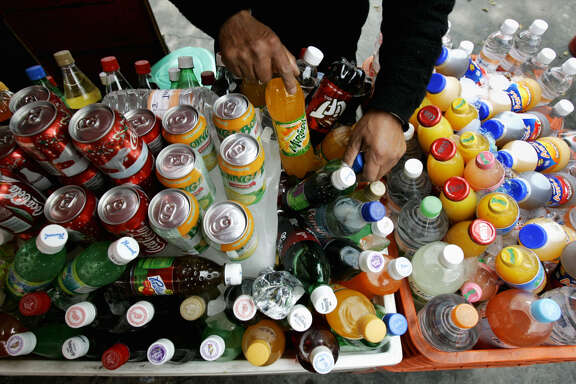 A street merchant arranges soft drinks in Mexico City on Dec. 20, 2006. The American Beverage Association has poured $7.7 million into the campaign to defeat the soda tax on San Francisco's November ballot.