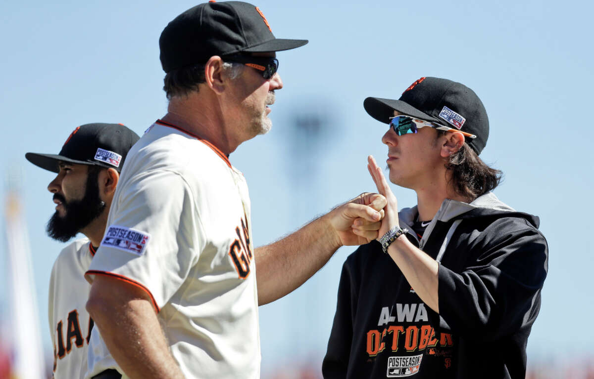 Tim Lincecum, right, has not pitched in the 2014 playoffs despite a 5-2 record and 2.47 ERA for his postseason career.