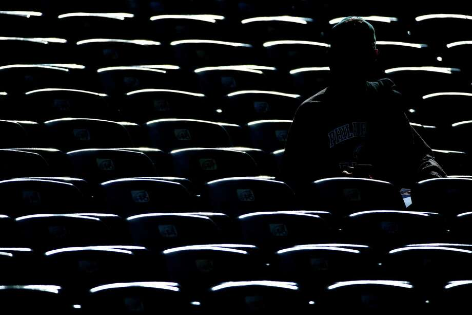 A Philadelphia Eagles fan sits in the stands at Lincoln Financial Field before an NFL football game against the St. Louis Rams, Sunday, Oct. 5, 2014, in Philadelphia. (AP Photo/Matt Rourke) ORG XMIT: PXE102 Photo: Matt Rourke / AP