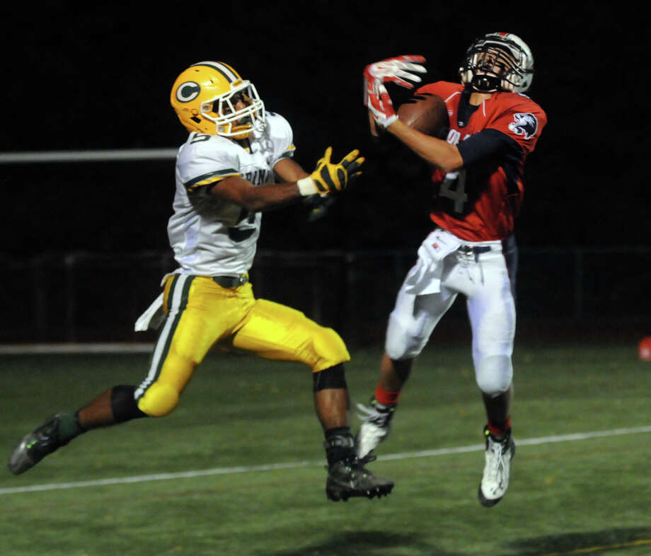 Foran's Steven Lynch intercepts the ball meant for Trinity's Randy Polonia as Foran High School hosts Trinity Catholic in a football game in Milford, Conn., Oct. 10, 2014. Photo: Keelin Daly / Stamford Advocate Freelance