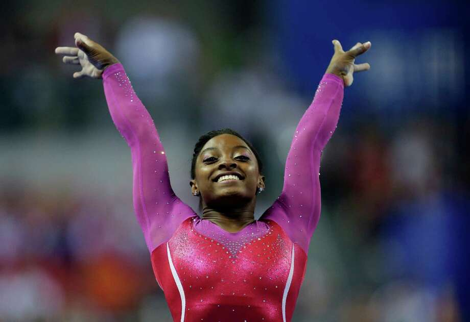 Simone Biles of the United States poses after completing her vault during the women's all-round final of the Artistic Gymnastics World Championship at the Guangxi Gymnasium in Nanning, capital of southwest China's Guangxi Zhuang Autonomous Region Friday, Oct. 10, 2014.  (AP Photo/Andy Wong) Photo: Andy Wong, STF / AP