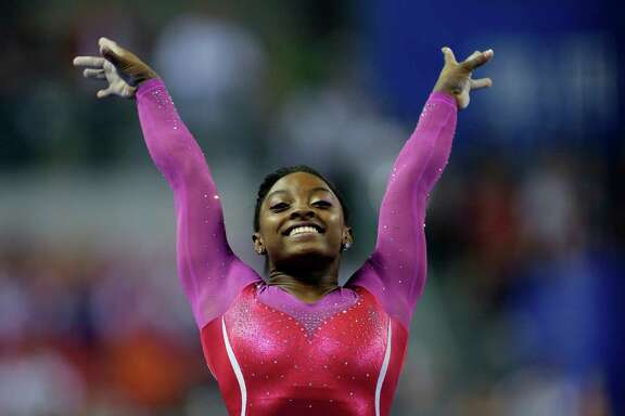 Simone Biles of the United States poses after completing her vault during the women's all-round final of the Artistic Gymnastics World Championship at the Guangxi Gymnasium in Nanning, capital of southwest China's Guangxi Zhuang Autonomous Region Friday, Oct. 10, 2014.  (AP Photo/Andy Wong)