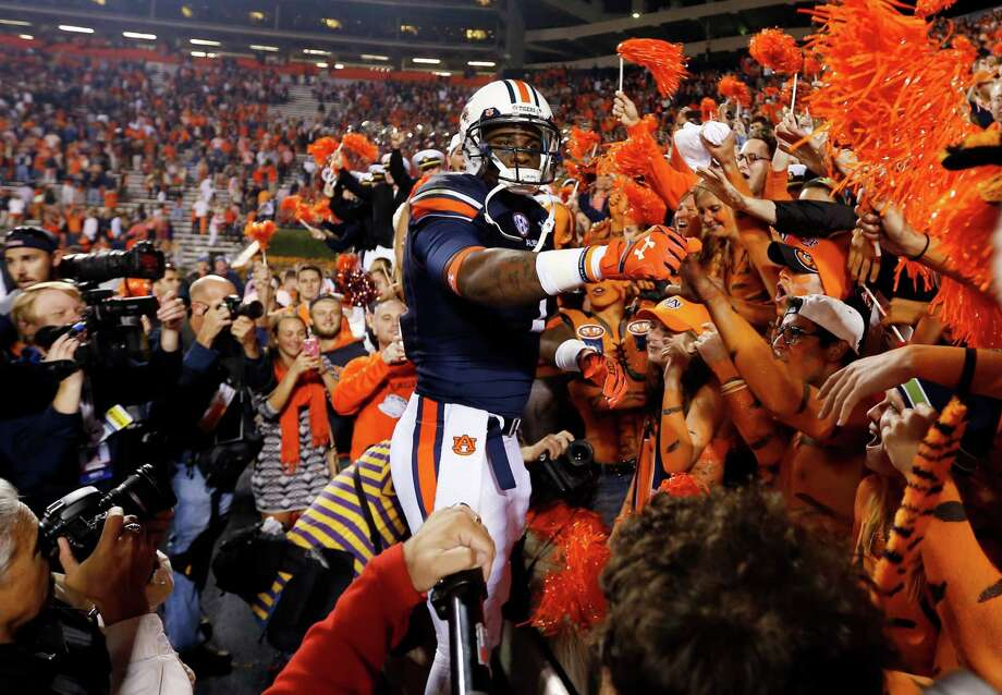 Auburn wide receiver D'haquille Williams (1) celebrates with fans after Auburn defeated LSU 41-7 in an NCAA college football game on Saturday, Oct. 4, 2014, in Auburn, Ala. (AP Photo/Butch Dill) ORG XMIT: ALBD116 Photo: Butch Dill / FR111446 AP