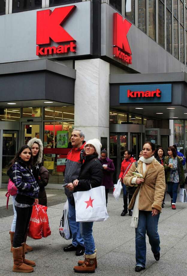 FILE - In this Tuesday, Dec. 27, 2011 file photo, pedestrians pass a Kmart store location in New York. On Friday, Oct. 10, 2014, Sears Holdings Corp. announced that it detected a data breach at its Kmart stores that started in August 2014, affecting certain customers' credit and debit card accounts. The data theft at Kmart is the latest in a string of data thefts that have hit several big retailers, including Target, Supervalu and Home Depot. (AP Photo/Frank Franklin II) Photo: Frank Franklin II / Associated Press / AP