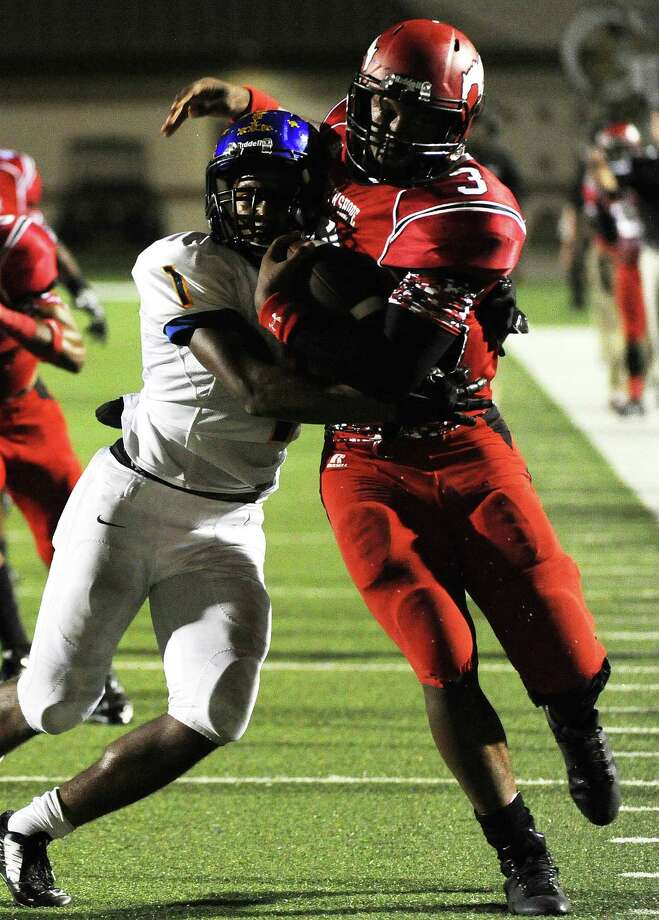 North Shore quarterback Maciah Long, right, is tackled by Channelview defensive back Darryn Cain during the first half of a high school football game, Friday, October 10, 2014, at Galena Park ISD Stadium in Houston. Photo: Eric Christian Smith, For The Chronicle / 2014 Eric Christian Smith