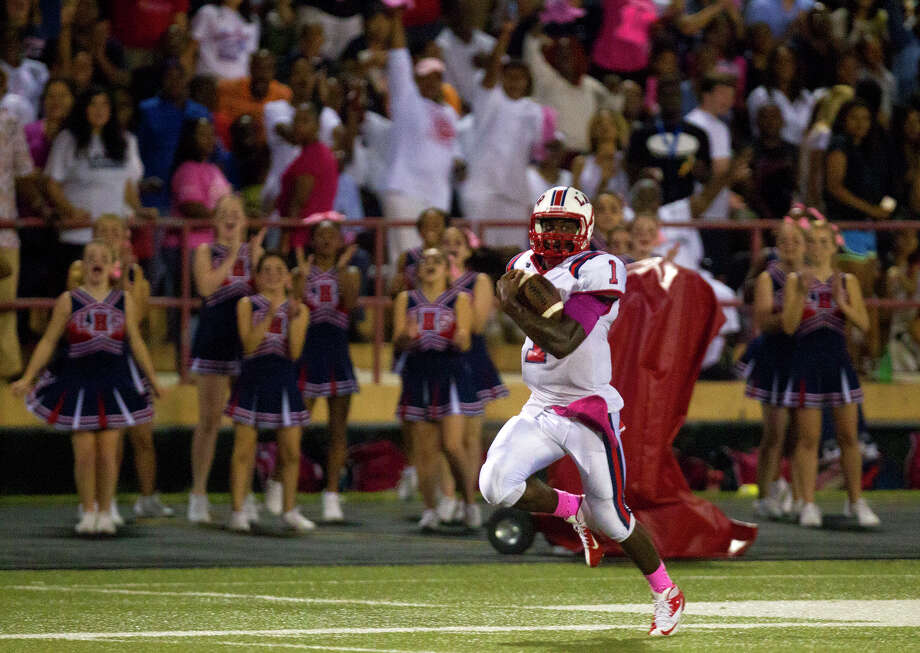 Lamar Texan quarterback JW Ketchum runs the ball for a touchdown during the second half of a football game against the Bellaire Cardinals, at Butler Stadium, Friday, Oct. 10, 2014, in Houston. Photo: Cody Duty, Houston Chronicle / © 2014 Houston Chronicle