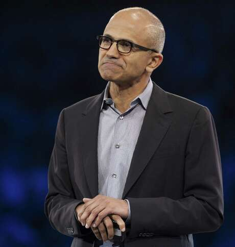 "(FILES) Microsoft CEO Satya Nadella speaks during his keynote address at the Microsoft Worldwide Partner Conference 2014 in Washington, DC, in this July 16, 2014, file photo. Nadella's gaffe over women, pay raises and karma comes as the US tech industry is facing up to questions over diversity and gender equality. Nadella, named CEO at the tech giant in April, swiftly backtracked from his comments in which he suggested working women should trust karma for pay raises. ""I answered that question completely wrong,"" Nadella said in a memo to staff, aiming to quell a firestorm over his comments at a conference on Ocober 9, 2014.      AFP PHOTO / Saul LOEB / FILESSAUL LOEB/AFP/Getty Images Photo: SAUL LOEB, Staff / AFP"