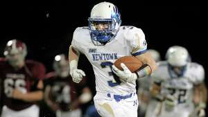 Photographs of Friday nights high school football game between Newtown and Bethel High School,  October 10, 2014, in Bethel, Conn.