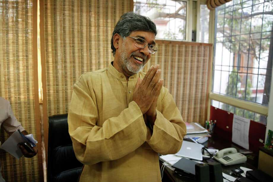Indian children's rights activist Kailash Satyarthi gestures as he addresses the media at his office in New Delhi, India, Friday, Oct. 10, 2014. Malala Yousafzai of Pakistan and Satyarthi of India jointly won the Nobel Peace Prize on Friday, Oct. 10, 2014, for risking their lives to fight for children's rights. (AP Photo/Manish Swarup) ORG XMIT: MSX103 Photo: Manish Swarup / AP
