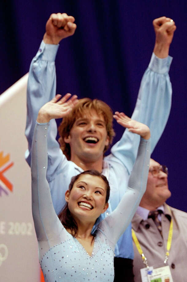US figure skaters Kyoko Ina and John Zimmerman celebrate their scores after competitng in the pairs free program in the Winter Olympics at the Salt Lake Ice Center in Salt Lake City, Monday, Feb. 11, 2002. (AP Photo/Lionel Cironneau) Photo: LIONEL CIRONNEAU / AP