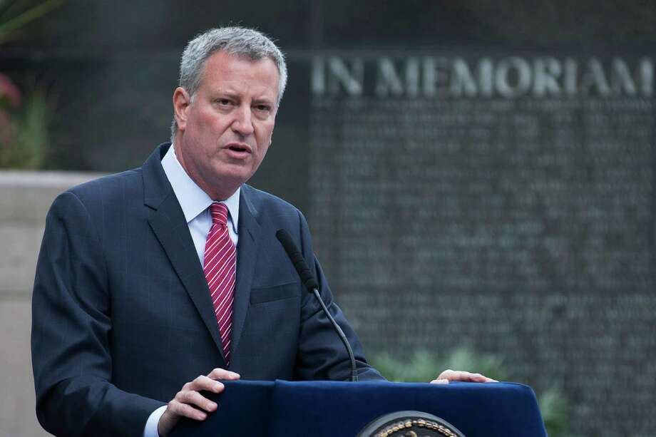 Mayor Bill de Blasio speaks at an NYPD Memorial ceremony on Friday, Oct. 10, 2014 in New York.  De Blasio's relationship with the NYPD comes under further scrutiny after more damaging revelations have come to light about top aide Rachel Noerdlinger. (AP Photo/John Minchillo) ORG XMIT: NYJM101 Photo: John Minchillo / FR170537 AP
