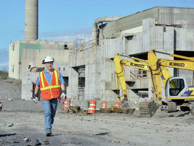 Lafarge Cement plant manager Mike Kralik walks through the Lafarge modernization project construction site Friday, Oct. 10, 2014, in Ravena, N.Y.  (John Carl D'Annibale / Times Union) Photo: John Carl D'Annibale / 10028994A