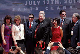 Santa Clara Mayor Jamie Matthews (center right) and 49ers CEO Jed York (center left) pose with family members after the ribbon cutting and official opening of Levi's Stadium.