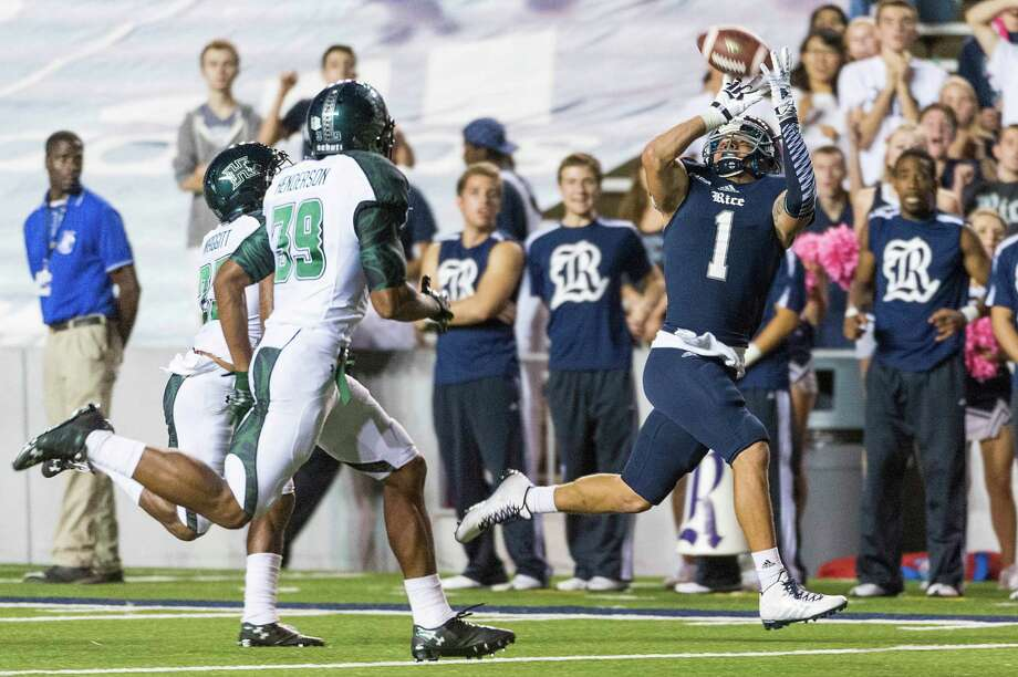 Rice wide receiver Mario Hull (1) has several big plays to his credit this season, including a 50-yard reception from quarterback Driphus Jackson in the second half of last week's game against Hawaii that kept the go-ahead touchdown drive alive. Photo: Smiley N. Pool, Staff / © 2014  Houston Chronicle