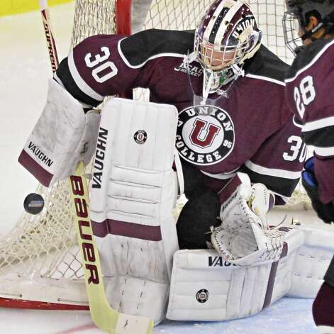 Union goalieColin Stevens stops a shot on goal during their season opener against American International at Messa Rink Friday Oct. 10, 2014, in Schenectady, NY.  (John Carl D'Annibale / Times Union) Photo: John Carl D'Annibale / 10028936A