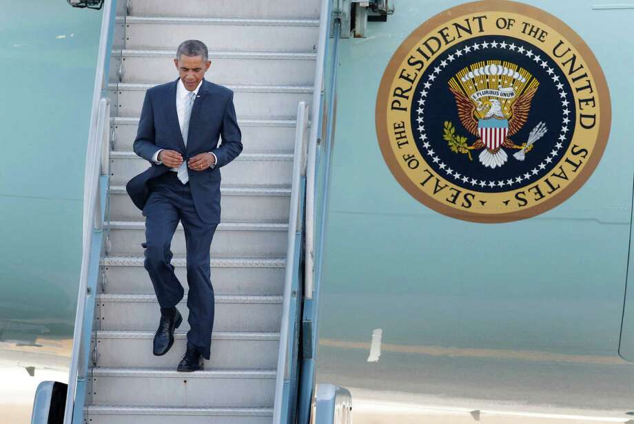 President Barack Obama walks to the tarmac after arriving at San Francisco International Airport on Air Force One on Friday, Oct. 10, 2014, in San Francisco. Photo: Lea Suzuki / The Chronicle / ONLINE_YES