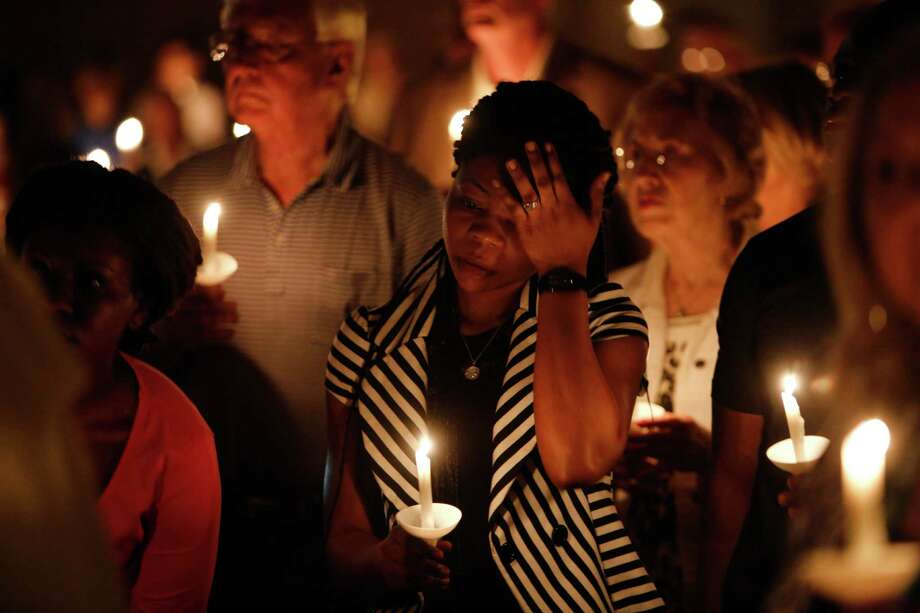 Mamie Mangoe, a friend of the Duncan family, wipes a tear away during a memorial service for Ebola victim Thomas Eric Duncan, on Wednesday Oct. 8, 2014 at at Wilshire Baptist Church in Dallas, TX.  Duncan died Wednesday morning at Texas Health Presbyterian Hospital of Dallas. (AP Photo/The Dallas Morning News, Nathan Hunsinger) Photo: Associated Press / The Dallas Morning News