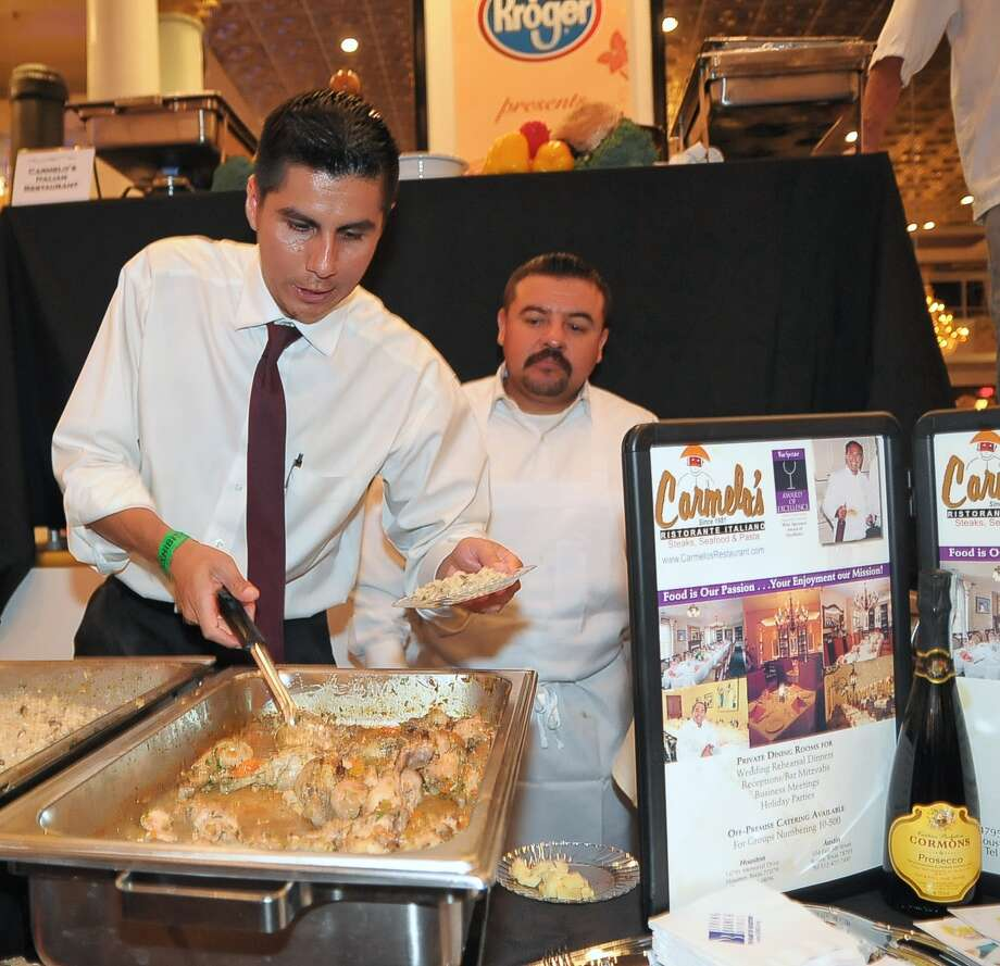 Nestor Patino and Hugo Gomez with Carmelos Restorante Italiano hand out samples of mushroom risotto and chicken during the 7th annual Zest in the West tasting event at Chateau Crystale benefiting the West Houston Leadership Institute in Houston, Texas Thursday October 9, 2014. Photo: Copyright Tony Bullard 2014, Freelance Photographer / Copyright 2014 Tony Bullard & the Houston Chronicle