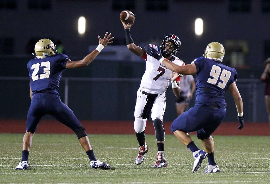Westfield quarterback Dillon Sterling-Cole gets a pass off under pressure by Cameron Goode and Diego Gomez of Klein Collins. Photo: Diana L. Porter, Freelance / © Diana L. Porter