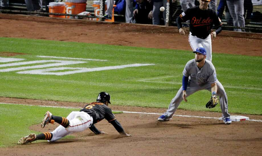 Baltimore Orioles second baseman Jonathan Schoop (6) slides safe into third as Kansas City Royals third baseman Mike Moustakas takes the throw during the sixth inning of Game 1 of the American League baseball championship series Friday, Oct. 10, 2014, in Baltimore. (AP Photo/Charlie Riedel)  ORG XMIT: ALCS210 Photo: Charlie Riedel / AP