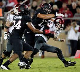 Stanford's A.J. Tarpley (center) sacks Washington State quarterback Connor Halliday during the second half.