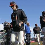Pitcher Tim Lincecum heads to the clubhouse after warm ups, as the San Francisco Giants prepare to take on the Washington Nationals in game four of the National League Division Series at AT&T Park in San Francisco.