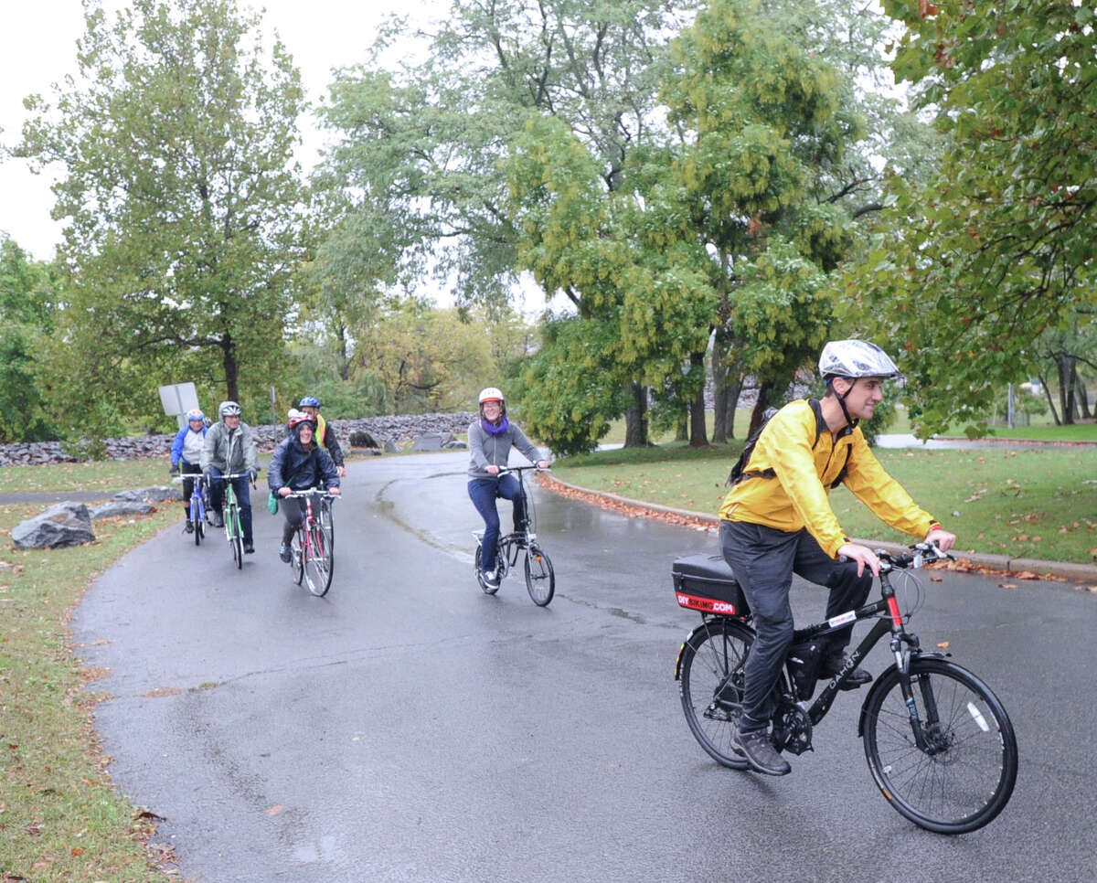 Stamford resident, Michael Norris, right, leads a group of bicycle riders into Kosciuszko Park, Stamford, Conn., Saturday morning, Oct. 11, 2014. The riders were participating in the Mill River Greenway Ride & Rally for the expansion of the Mill River Park Greenway and new bike lanes in Stamford. The rally started in Scalzi Park.