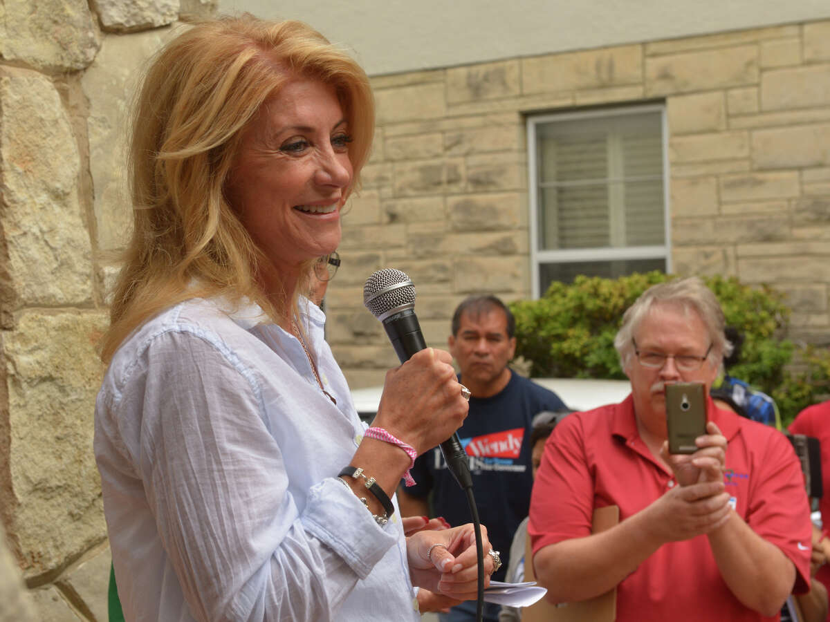 Democratic gubernatorial candidate Wendy Davis speaks during a community block walk with campaign supporters Saturday in San Antonio. She was speaking at the west side home of Alicia Hilton.