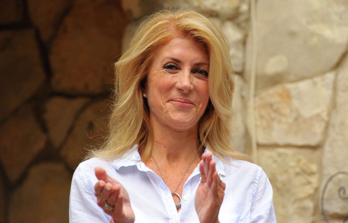 Democratic gubernatorial candidate Wendy Davis smiles after giving remarks during a community block walk with campaign supporters Saturday in San Antonio.