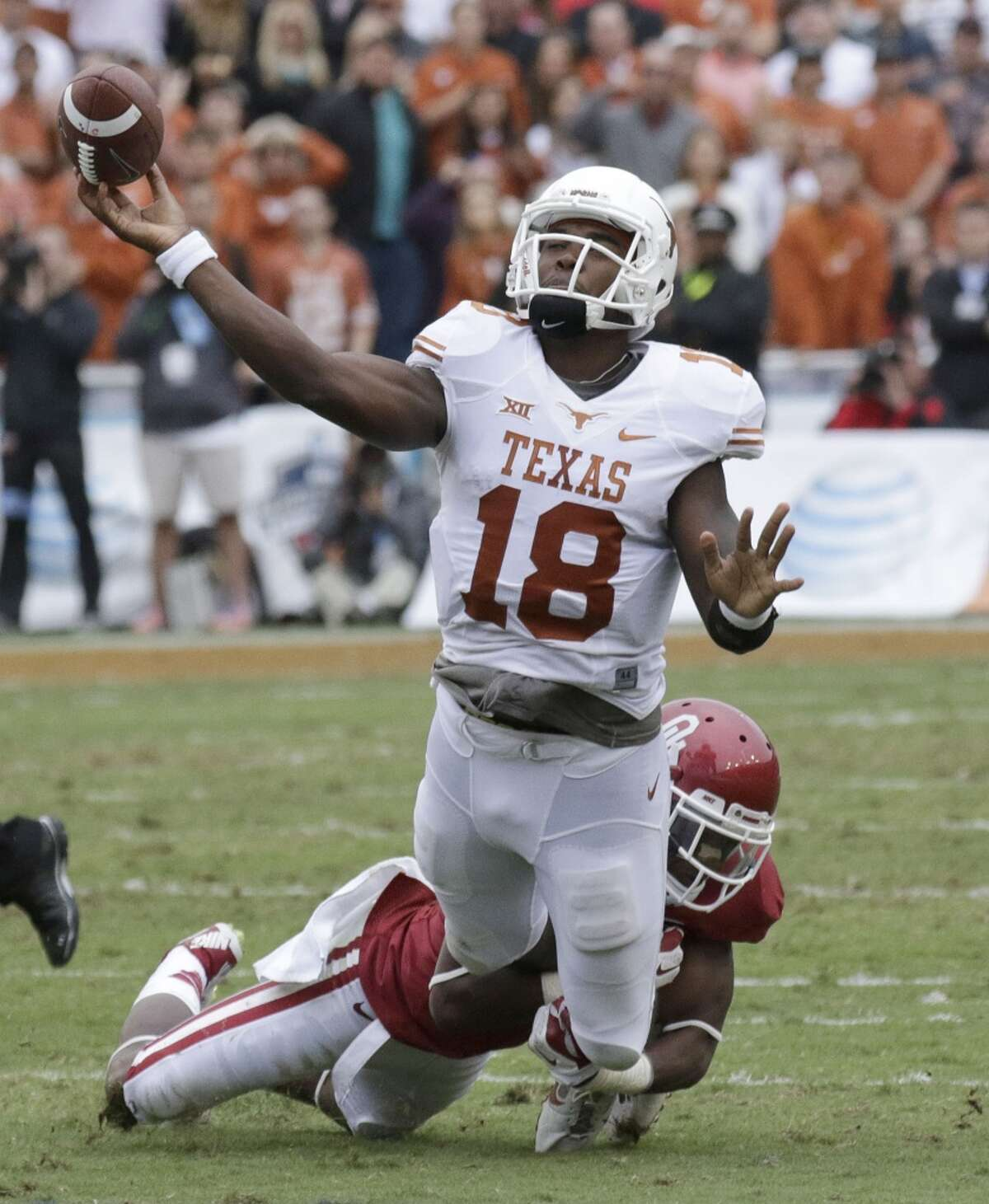Oct. 11: Oklahoma 31, Texas 26 Texas quarterback Tyrone Swoopes (18) is tripped up by while passing against Oklahoma safety Quentin Hayes (10) during the second half.