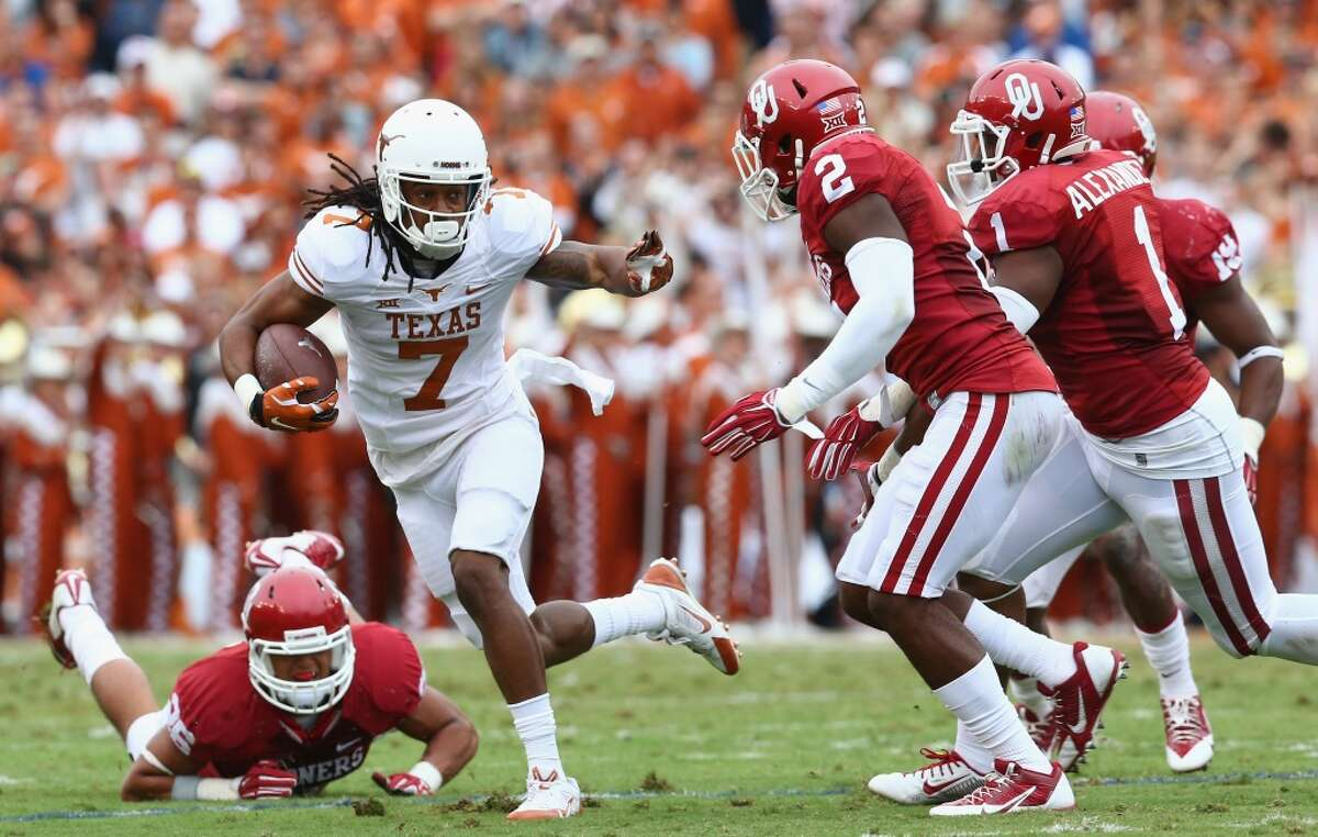 DALLAS, TX - OCTOBER 11: Marcus Johnson #7 of the Texas Longhorns runs the ball against Julian Wilson #2 of the Oklahoma Sooners at Cotton Bowl on October 11, 2014 in Dallas, Texas. (Photo by Ronald Martinez/Getty Images)